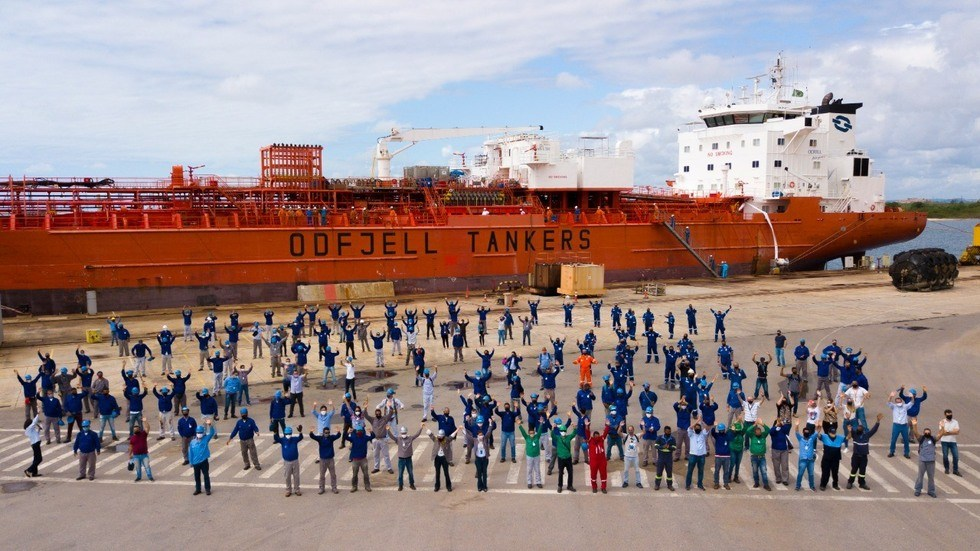 The team from EAS, Flumar and Odfjell gather in front of Bow Atlantic at the EAS shipyard in Brasil.