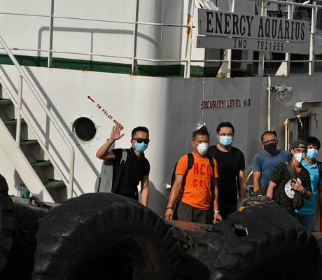 Seafarers disembark Odfjell's chemical tanker Bow Sun after the ship was rerouted to Manila for the sole purpose of facilitating crew changes during the Covid-19 pandemic.